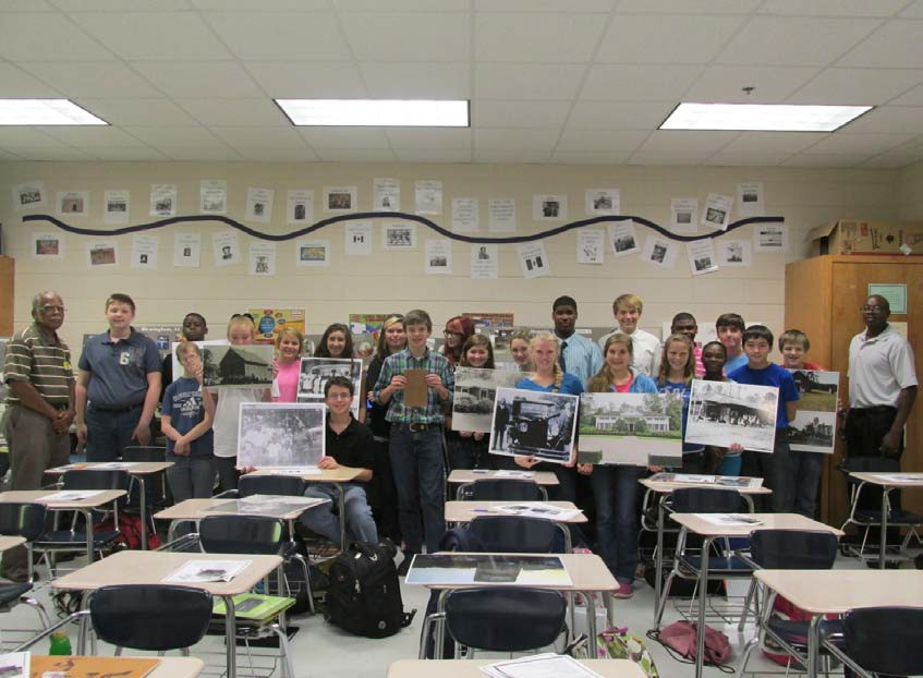 "National History Day at Thomas County Middle School. This is a ""highly regarded academic program"" held annually for more than half a million elementary and secondary school students nationwide. Jack standing left and Walter on the right are the museum presenters for the event addresses Deann Garcia's eighth-grade Georgia History class in preparation for Nation History Day in 2014."