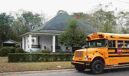 Tour bus by Richard Williams' home, 310 Magnolia St.
