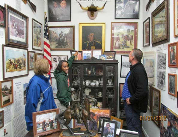 "Brittanye Jacobs, a FAMU Intern graduate, giving a museum tour. She has completed 14 weeks internship at the museum. Brittanye also attended with President Jack Hadley, a museum preservation care workshop, sponsored by Smithsonian's National Museum of African American History & Culture, presents-""Save Our African American Treasures"" in association with Albany State University, Albany, Georgia."