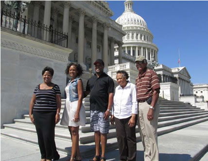"""Our 2013 milestone was a trip to the Capital at Washington, DC, to receive the Congressional Black Caucus Veterans Braintrust Award for 2013. The President James """"Jack"""" Hadley's family attended the ceremony with him. Standing on the Capital's steps: L to R: Our daughters and son-in-law, Jackie H. Artybridge, Cathy H Wilson and husband, Eugene Wilson, Jack's wife, Christine Hadley and Jack Hadley"""